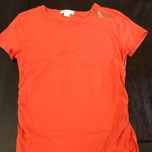 Michael Kors orange shirt with zipper.